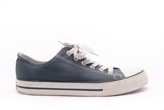 Blue walking shoe. Old blue walking shoe isolated on white background Stock Image