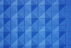 Blue Wall. A textured brick wall painted blue Stock Images