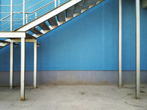 Blue wall. Wall background under metal staircase Stock Photo