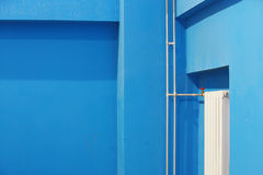 Blue wall inside building. The blue wall in the building Stock Photography