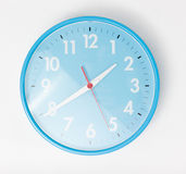 A blue wall clocks on white ground Stock Image