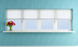 Blue wall with closed window Royalty Free Stock Image