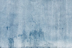 Blue Wall Cracked. Blue  paint on an exterior wall cracked and flaking to reveal old concrete beneath Royalty Free Stock Photos
