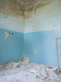 Blue wall of a dilapidated room Stock Image