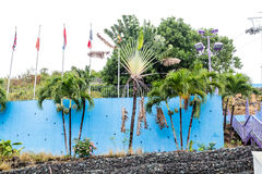 Blue Wall with Flags in Tropics Royalty Free Stock Images