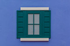 Blue wall and green round arch window Stock Images