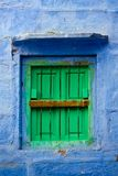 Blue wall and green shutters. Jodhpur, Rajasthan, India Royalty Free Stock Photos