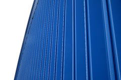Blue wall of the hangar. Fragment blue ribbed metal roof on a background of  sky Stock Photo