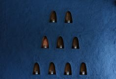 Blue walls, candles in the little box. royalty free stock photos