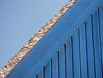 Blue wall of a house. The blue wall of a house and the roof royalty free stock photos