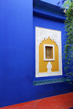 Blue wall with islamic art window. Stock Photo
