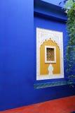 Blue wall with islamic art window. Stock Photo