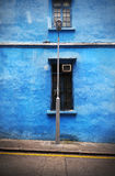 Blue Wall and Lamppost Stock Photos