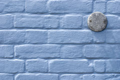 Blue wall with number plate Royalty Free Stock Photo