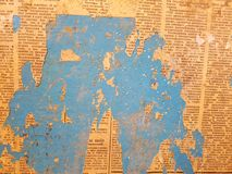 Blue wall. The old wall is covered with newspapers Stock Images