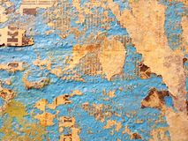 Blue wall. The old wall is covered with newspapers Royalty Free Stock Images