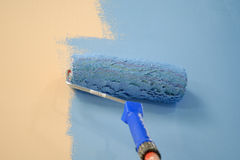 Blue wall painting roller Royalty Free Stock Photo