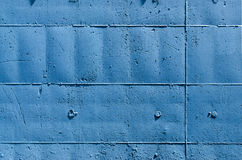 Blue Wall with Rectangles. Blue tinted outer wall, with signs on the surface of the molds that were used in their construction Royalty Free Stock Photos