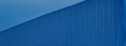 Blue wall and blue sky. A picture of a blue wall with lines,and a blue sky above,in a town in Greece,Thessaloniki Stock Images