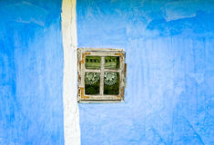 Blue Wall with Small Window Royalty Free Stock Images