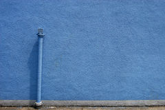 Blue Wall & Tailpipe. A comfortable match on wall Royalty Free Stock Photo