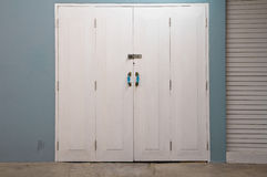 Blue wall white door Royalty Free Stock Photography