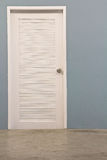 Blue wall white door Stock Photo