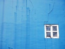 Blue wall with white window frame Royalty Free Stock Image