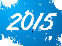Blue wallpaper with 2015 text and splatters Royalty Free Stock Photography