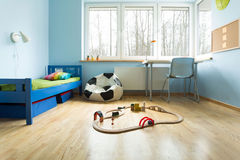 Blue walls in boy's room Stock Photos