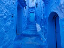 Blue walls, stairs and doors of the alley of medina of Chefchaouen, Morocco. Blue walls, stairs and doors of the alley of the medina of Chefchaouen, Morocco Royalty Free Stock Photography