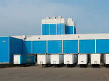 Blue warehouse. Modern blue warehouse with loading docks Royalty Free Stock Images