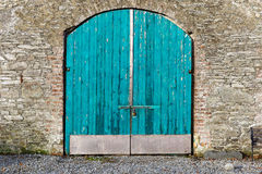 Blue warehouse door. Photo of a closed blue warehouse door Royalty Free Stock Image