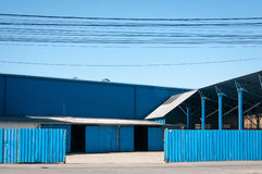 Blue warehouses. In a sunny day Stock Images
