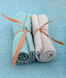 Blue wash cloths rolled up at spa Royalty Free Stock Image