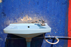 Blue washbasin with faucet Stock Photo
