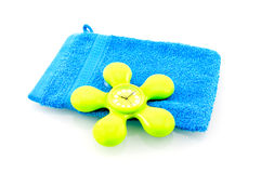 Blue washcloth with green shower clock Royalty Free Stock Photo