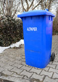 Blue waste bin with german sign reading Wastepaper Stock Image