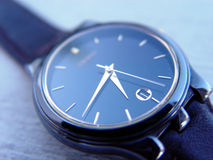 Blue watch. Close up of a blue watch with focus on hands and calendar royalty free stock image