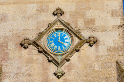 Blue watch on wall. On facade to a church is a blue watch Stock Images
