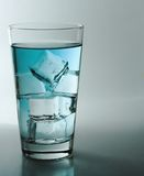 Blue water. Glass of blue water stock photo