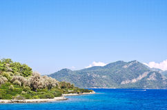 The blue water of the Aegean Sea off the coast of the island Royalty Free Stock Images