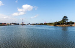 Blue Water Against Harbor and City Skyline in Durban Stock Photography