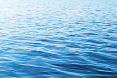 Blue water background with soft waves Stock Photography