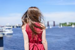 Blue water beauty nature sly clouds resort tour deck cruise concept. Rear back behind view portrait photo of beautiful pretty lad royalty free stock images
