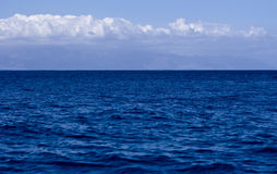 Blue water blue sky royalty free stock photos