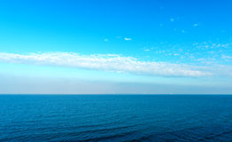 Seascape. Blue sea or ocean water surface with horizon and sky royalty free stock photography