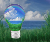 Blue water with blue sky white clouds in light bulb seem save nature and good environment Royalty Free Stock Image