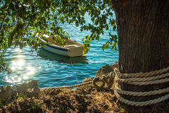 Blue water boat. Boat on water summer Montenegro royalty free stock photo