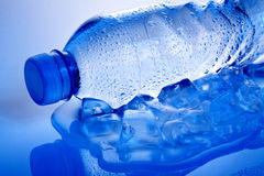 Blue water bottle on ice Stock Image